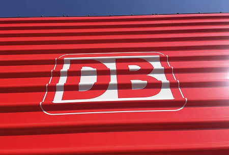 White deutsche bahn logo on a red back ground