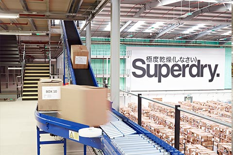 A belt and roller conveyor inside a Superdry factory