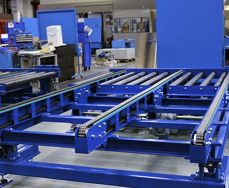 A blue chain conveyor