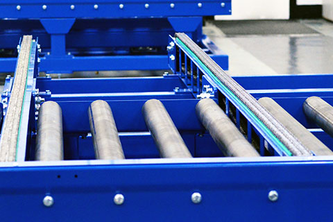 A close up of a blue chain conveyor