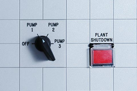 A pump dial and a plant shutdown switch
