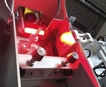 Close up of the Exhaust leak test machine, lit up by a red light