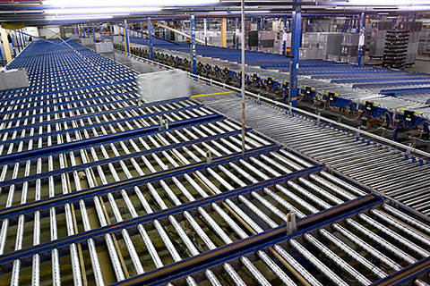 A gravity roller conveyor in a warehouse