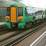 A fast moving green train