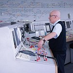 Signalman using a panel with many buttons and switches