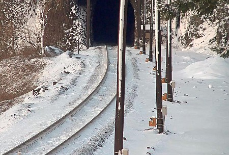 Train tunnel with LIDAR poles to the right edge of the train tracks