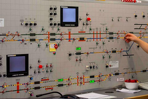 A rail signalling control panel with various controls, buttons and dials