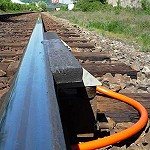 Train tracks with top of rail lubrication device fitted